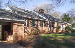 A classic brick ranch house, before.
